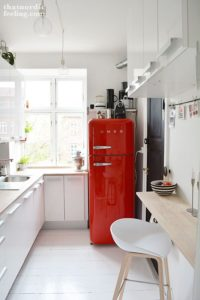 A Cherry Red Fridge Is The Focal Point